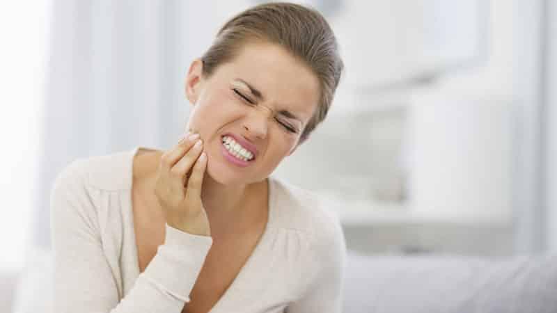 Сколько болит десна после удаления зуба мудрости