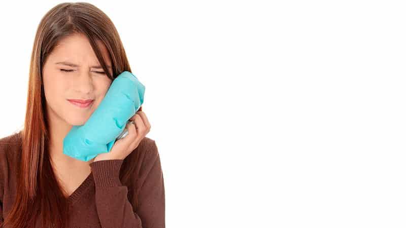 Как снять опухлость щеки