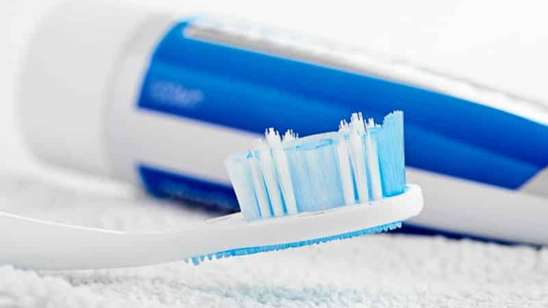 от чего появляется зубной камень причины