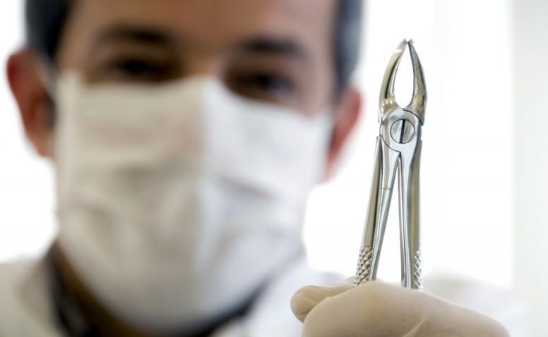 где можно удалить зуб бесплатно